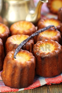 Small French cakes Canele and vanilla.