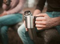Males Hand With Cup And Thermos, Camping Break