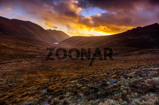 Beautiful valley with water reservoir in Mourne Mountains at golden hour and dramatic sunset