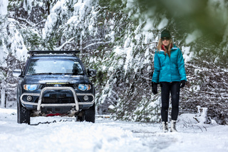 Out in snow covered forest with 4wd ute
