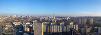 Panoramic view from drone of city landscape with buildings.
