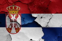 flags of Serbia and Netherlands painted on cracked wall