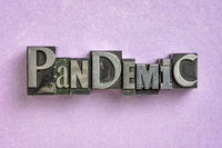 pandemic word  in gritty vintage letterpress metal types