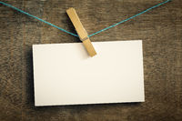 card on wire with clothes peg