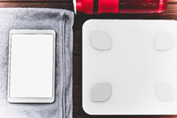 dieting and control calories for good health concept. smart weight scales tablet device and Drinking bottle on board. fitness concept
