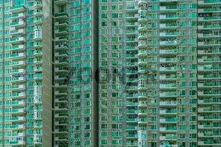 Shenzhen - green appartment block in megacity at daylight