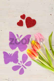 Tulips, butterflies and hearts as spring courier