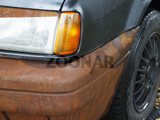 Car with a rusted bumper