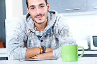 Young man with tablet in the kitchen