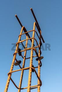 Pillar rebars against sky in construction site