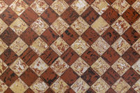 Old fashioned antique brown beige floor tiles