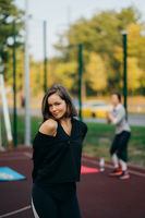 Beautiful young woman on the playground looking at the camera