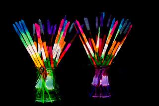 Colored and fragrance handmade incense sticks on black background