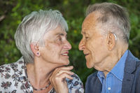 Retired couple shortly before a kiss