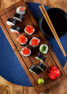 A set of sushi rolls with red caviar, ginger and wasabi