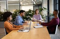 Diverse group of business people working in creative office