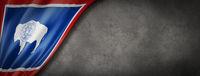 Wyoming flag on concrete wall banner, USA
