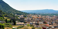 Panoramic image residential buildings typical spanish village, view from above to hillside houses of Xativa town. Valencian Community. Spain