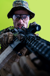 soldier in action aiming laseer sight optics green background