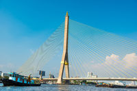 View to suspension bridge across river in Bangkok