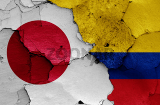 flags of Japan and Colombia painted on cracked wall