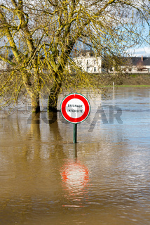 Flooded sign which reads no swimming, in France