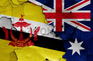 flags of Brunei and Australia painted on cracked wall