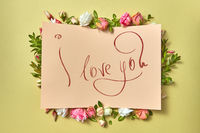 Written text card I love you in the flowers frame.