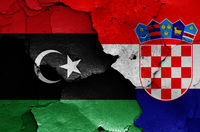 flags of Libya and Croatia painted on cracked wall