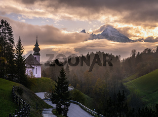 Maria Gern pilgrimage church and mount Watzmann top silhouette through fog, Berchtesgaden, Germany