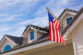 American Flag Hanging From House Facade