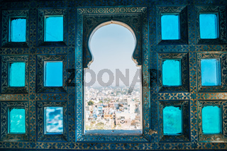 Indian style window and Udaipur city view from City Palace in India