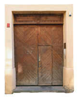The central front wooden door to the old public medieval  church isolated