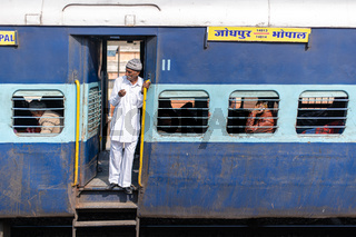 Man in a door of an Indian Train
