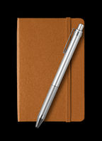 Leather closed notebook and pen isolated on black