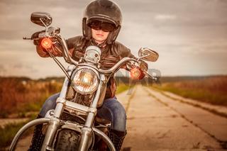 Biker girl on a motorcycle