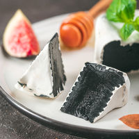 Unusual black camembert cheese with white mildew