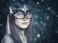 Christmas Party. Carnival female portrait with beauty backgrounds