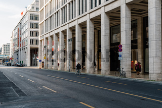 Scenic view of Friedrichstrasse in Berlin with luxury stores along the colonnade