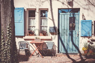 Garden furniture outside a house with blue door
