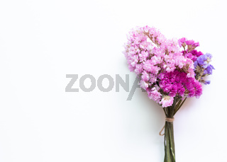 Pink purple statice flowers bouquet on white background. Floral composition, flat lay, top view