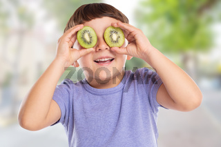 Little boy child with kiwi fruit having fun town happy happiness healthy eating