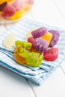 Colorful fruity jelly candies on checkered napkin.