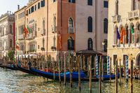 Traditional view of Venice, famous Gondolas in the canal and venetian palaces, Italy