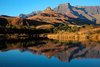 Sandstone mountains and reflection