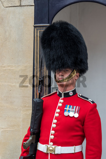 WINDSOR, MAIDENHEAD  WINDSOR/UK - JULY 22 : Coldstream Guard on duty at Windsor Castle in Windsor, Maidenhead  Windsor on July 22, 2018. One unidentified man