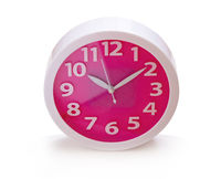 photo round red-pink clock, on white background, isolated