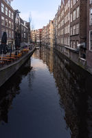 Day time view down Oudezijds Achterburgwal canal street in the world famous Red Light District of Amsterdam