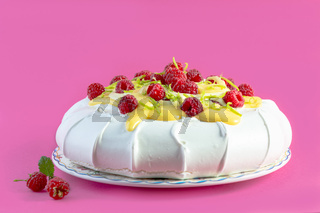 Pavlova dessert with raspberries.