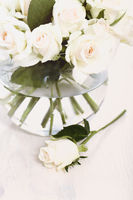 White roses on glass vase
